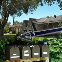 Residences, a cluster of mailboxes, and an arrow