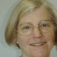 Woman with glasses and a short blonde bob haircut