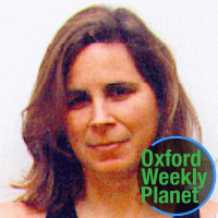 Woman with shoulder-length brown hair with the Oxford Weekly Planet logo in the bottom right corner