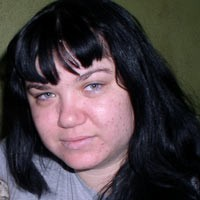Young woman with dark hair and bangs