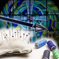 Arrow, pincushion and spools of thread with a stained glass window in the background