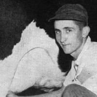 Old photo of a young, angular man in a dark baseball cap