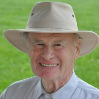 Smiling white-haired man wearing a panama hat