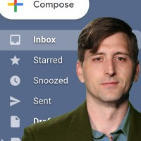 Dark-haired man in front of a screengrab of an email inbox
