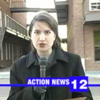 A local TV news reporter is live at the crime scene