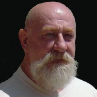 Older bald man with white beard and mustache
