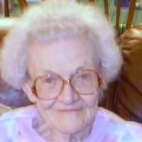 Elderly woman with white hair and glasses