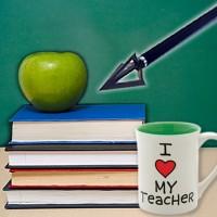 apple, stack of books, teacher's mug and arrow in front of a chalkboard