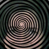 Hypnotic spiral with a woman's face in the background