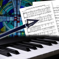 Piano keyboard, musical score, and an arrow in front of a stained glass window
