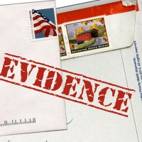 "Photo of mailed letters with the word ""Evidence"" stamped on them"