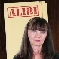 Woman with long dark hair and bangs in front of a manila folder stamped 'Alibi'