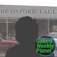 Silhouette of a man with the Oxford Eagle office in the background and the Oxford Weekly Planet logo superimposed