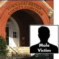 Entrance to the Yoknapatawpha County Coroner's Office with the label 'Male Victim'