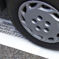Vehicle tire leaving an inked imprint on white paper