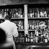 Old photo of a bartender behind a bar