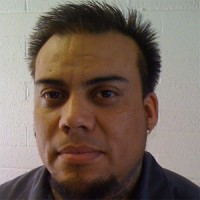 Man with short, spiky dark hair and goatee