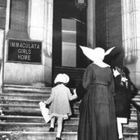 Old photo of a nun and two children entering the Immaculata Girls Home