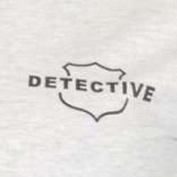 Detective shield close-up