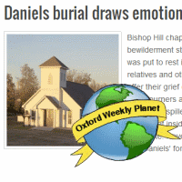 Daniels burial draws emotional crowd